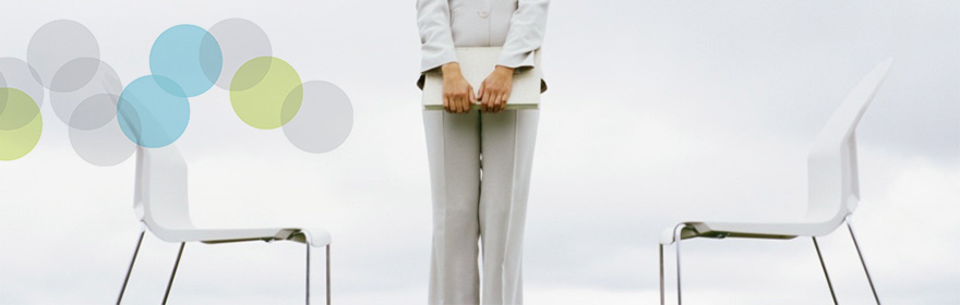 business woman between 2 white chairs